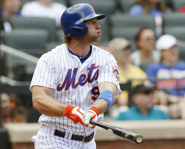 New York Mets Kirk Nieuwenhuis (9) hits a third-inning, two-run, home run, his second home run of the game, in a baseball game against the Arizona Diamondbacks in New York, Sunday, July 12, 2015. (AP Photo/Kathy Willens)