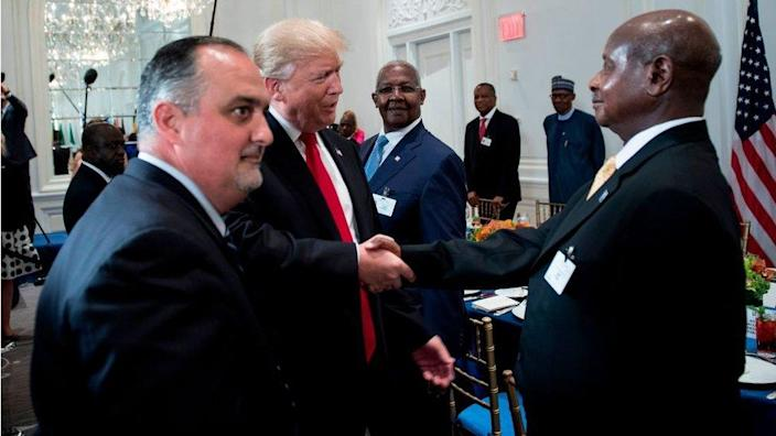 US President Donald Trump (C) greets Uganda's President Yowri Kaguta Museveni (R) before a luncheon with US and African leaders at the Palace Hotel during the 72nd United Nations General Assembly on September 20, 2017