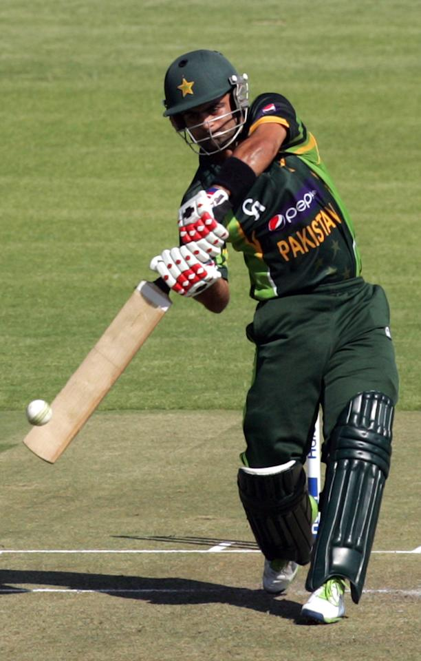 Pakistan's batsman Ahmed Shehzad plays a shot during the second and final Twenty20 international between Zimbabwe and Pakistan at the Harare Sports Club on August 24, 2013.   AFP PHOTO / JEKESAI NJIKIZANA        (Photo credit should read JEKESAI NJIKIZANA/AFP/Getty Images)