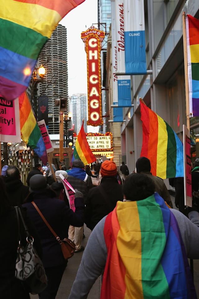 CHICAGO, IL - MARCH 25:  Gay rights activist rally in support of gay marriage March 25, 2013 in Chicago, Illinois. The Supreme Court will hear arguments this week in two cases that could determine if states or the federal government can treat same-sex couples and those of the opposite sex differently when recognizing a marriage. The Illinois Senate has approved legislation that will legalize same-sex marriage in the state but it still has to be approved by the Illinois House and signed by Governor Pat Quinn, who has said he supports the legislation. If passed Illinois would become the tenth state to allow same-sex marriage. Thirty states have defined marriage as a union between a man and a woman.  (Photo by Scott Olson/Getty Images)