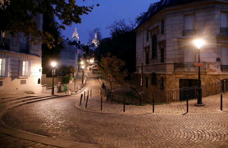 FILE PHOTO: Empty streets are seen in Montmartre few minutes before the late-night curfew due to restrictions against the spread of the coronavirus disease (COVID-19) in Paris