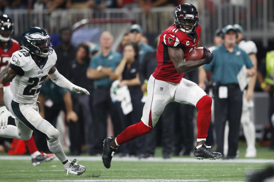 FILE - Atlanta Falcons wide receiver Julio Jones (11) runs toward the end zone for a touchdown against Philadelphia Eagles free safety Rodney McLeod (23) during the second half of an NFL football game in Atlanta, in this Sunday, Sept. 15, 2019, file photo. The Tennessee Titans have traded with the Atlanta Falcons for seven-time Pro Bowl wide receiver Julio Jones, a person familiar with the situation told The Associated Press. (AP Photo/John Bazemore, File)