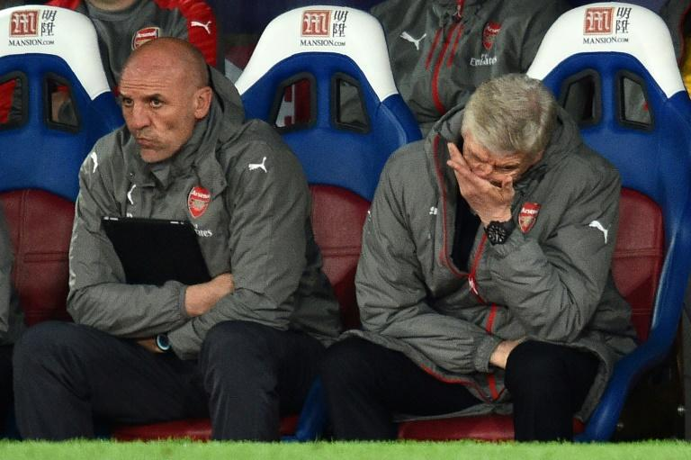 Arsenal fans subjected manager Arsene Wenger (R) to a stream of abuse and calls to resign as the team lost to Crystal Palace
