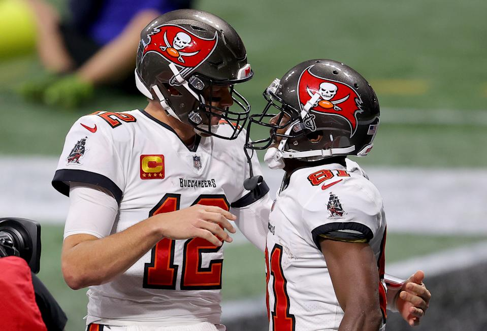 ATLANTA, GEORGIA - DECEMBER 20: Antonio Brown #81 of the Tampa Bay Buccaneers celebrates with Tom Brady #12 after scoring a 46 touchdown against the Atlanta Falcons during the fourth quarter in the game at Mercedes-Benz Stadium on December 20, 2020 in Atlanta, Georgia. (Photo by Kevin C. Cox/Getty Images)