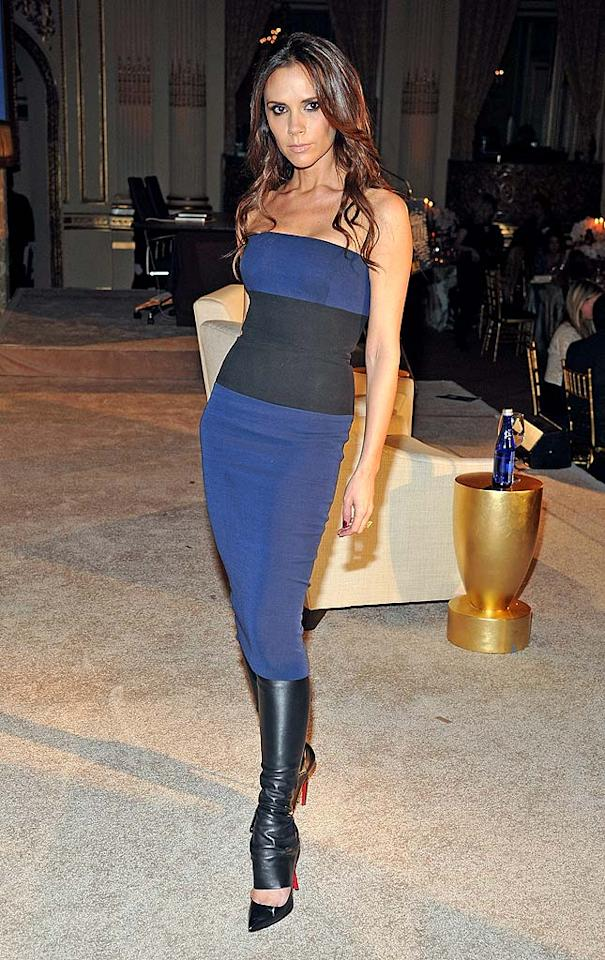 "Victoria Beckham has kept a low profile since giving birth to daughter Harper in July, but the hot mama made a triumphant return to the spotlight on Monday evening at the <i>Women's Wear Daily</i> Apparel & Retail Summit in NYC. Beckham -- who was in attendance to discuss her latest fashion line -- looked svelte in one of her own cutting-edge designs: a strapless, color-blocked frock paired with leather leggings. Christian Louboutin heels and wavy tresses completed her ""posh"" look.  (11/14/2011)"