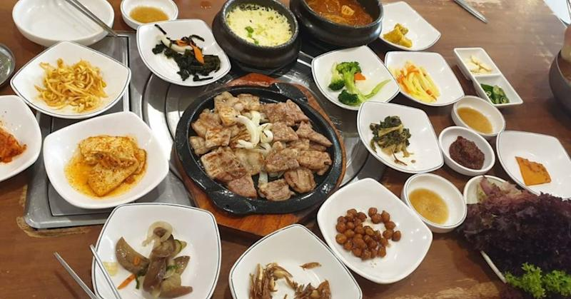 Korean barbecue dish surrounded by banchan. Photo: Sarah Leong /Instagram