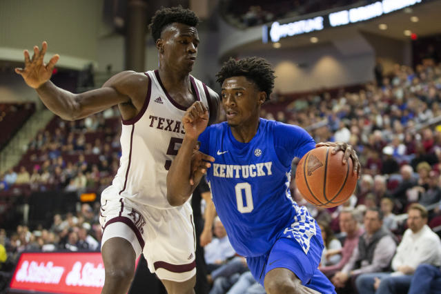 Kentucky guard Ashton Hagans (0) drives the baseline against Texas A&M forward Emanuel Miller (5) during the first half of an NCAA college basketball game Tuesday, Feb. 25, 2020, in College Station, Texas. (AP Photo/Sam Craft)