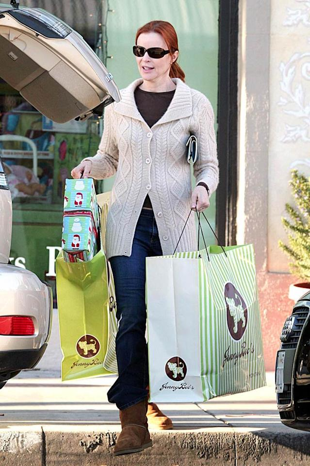 """Marcia Cross loads up on goodies from Jenny Bec's, a whimsical toy store on Montana Avenue in Santa Monica, California. Kevin Perkins/<a href=""""http://www.pacificcoastnews.com/"""" target=""""new"""">PacificCoastNews.com</a> - December 18, 2008"""