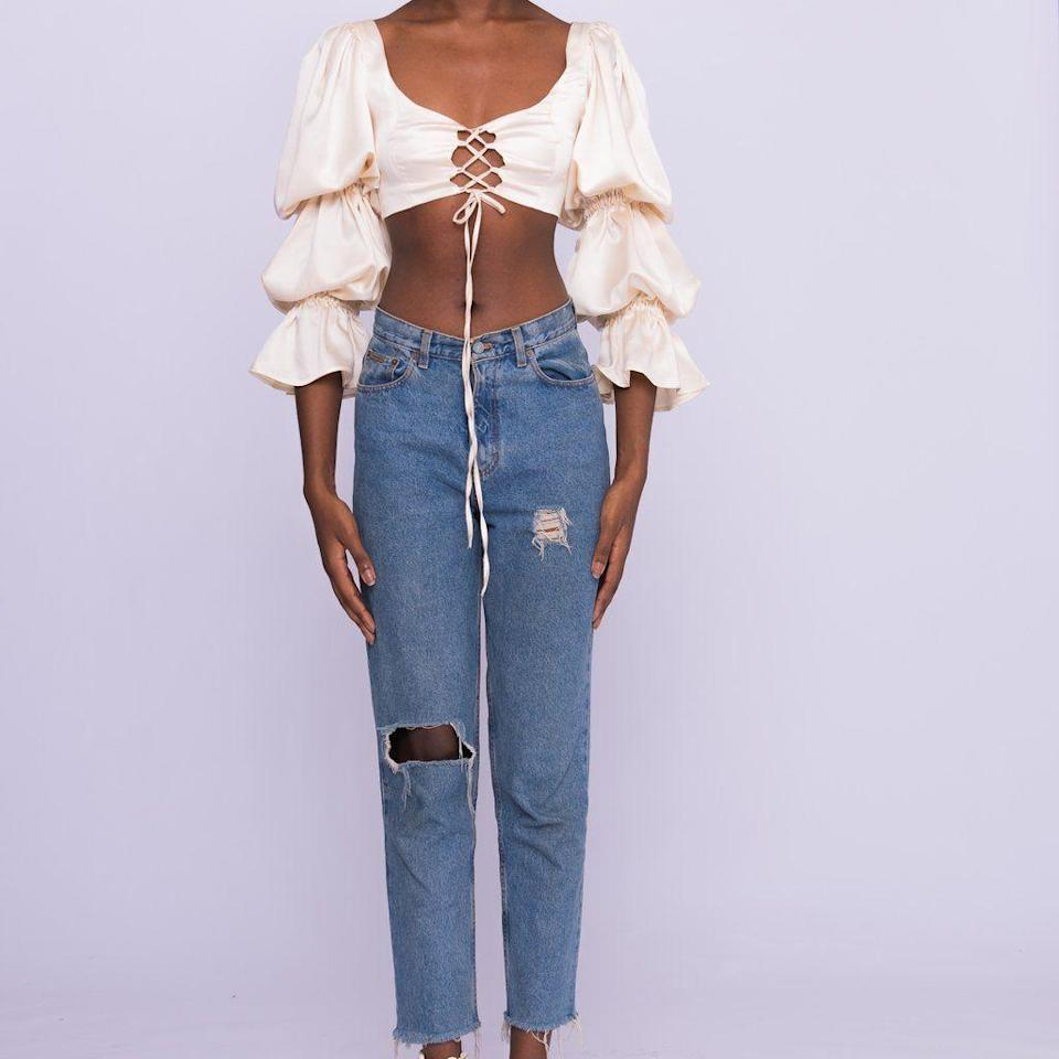 """<p><strong>Kilentar</strong></p><p>kilentar.com</p><p><strong>£80.00</strong></p><p><a href=""""https://kilentar.com/collections/2020/products/flare-puff-sleeves"""" rel=""""nofollow noopener"""" target=""""_blank"""" data-ylk=""""slk:Shop Now"""" class=""""link rapid-noclick-resp"""">Shop Now</a></p><p>Keep your crop tops in rotation with a pair of high-waist jeans. Oh, and don't forget your jacket.</p>"""