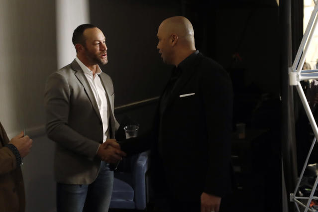 New York Mets manager Carlos Beltran, right, greets San Francisco Giants manager Gabe Kapler between news conferences during the Major League Baseball winter meetings, Tuesday, Dec. 10, 2019, in San Diego. (AP Photo/Gregory Bull)