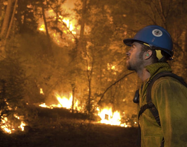 An unidentified firefighter monitors a controlled backfire Friday, Aug. 17, 2012, as firefighters battled the Trinity Ridge Fire near Featherville, Idaho, in this photo released Aug. 19. More than 1,100 firefighters worked to protect some 350 homes in the area under an evacuation order because of the 138-square-mile blaze. (AP Photo/U.S. Forest Service, Kari Greer)