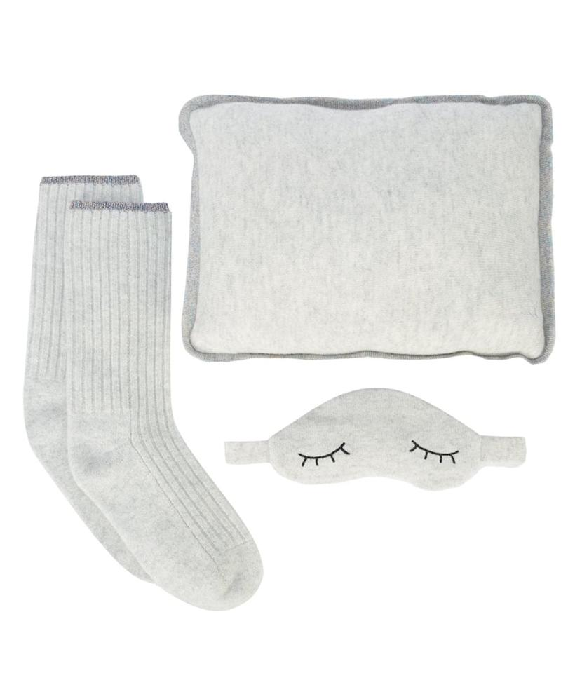 "<p>Sleep is an indulgence we can all get behind, especially when it comes with cashmere. Give the ultimate cozy set with this adorable <a rel=""nofollow"" href=""https://www.popsugar.com/buy/Morgane%20Lane%20Sleepy%20gift%20set-395520?p_name=Morgane%20Lane%20Sleepy%20gift%20set&retailer=farfetch.com&price=508&evar1=fab%3Aus&evar9=32546198&evar98=https%3A%2F%2Fwww.popsugar.com%2Ffashion%2Fphoto-gallery%2F32546198%2Fimage%2F44265469%2FMorgane-Lane-Sleepy-gift-set&list1=shopping%2Cmoda%20operandi%2Cluxury%20fashion%2Cmorgane%20lane&prop13=desktop&pdata=1"" rel=""nofollow"">Morgane Lane Sleepy gift set</a> ($508).</p>"