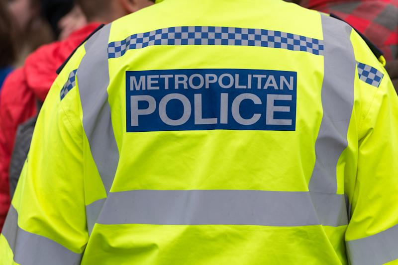 Back view of metropolitan police officers jacket.