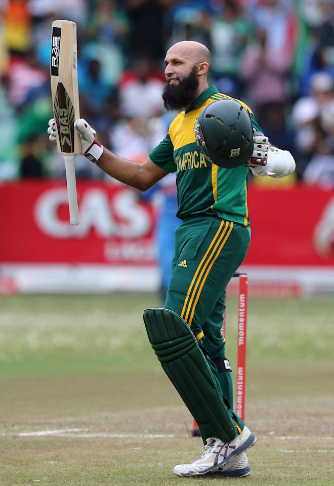 DURBAN, SOUTH AFRICA - DECEMBER 08:  Hashim Amla gets 100 runs during the 2nd Momentum ODI match between South Africa and India at Sahara Stadium Kingsmead on December 08, 2013 in Durban, South Africa. (Photo by Anesh Debiky/Gallo Images/Getty Images)