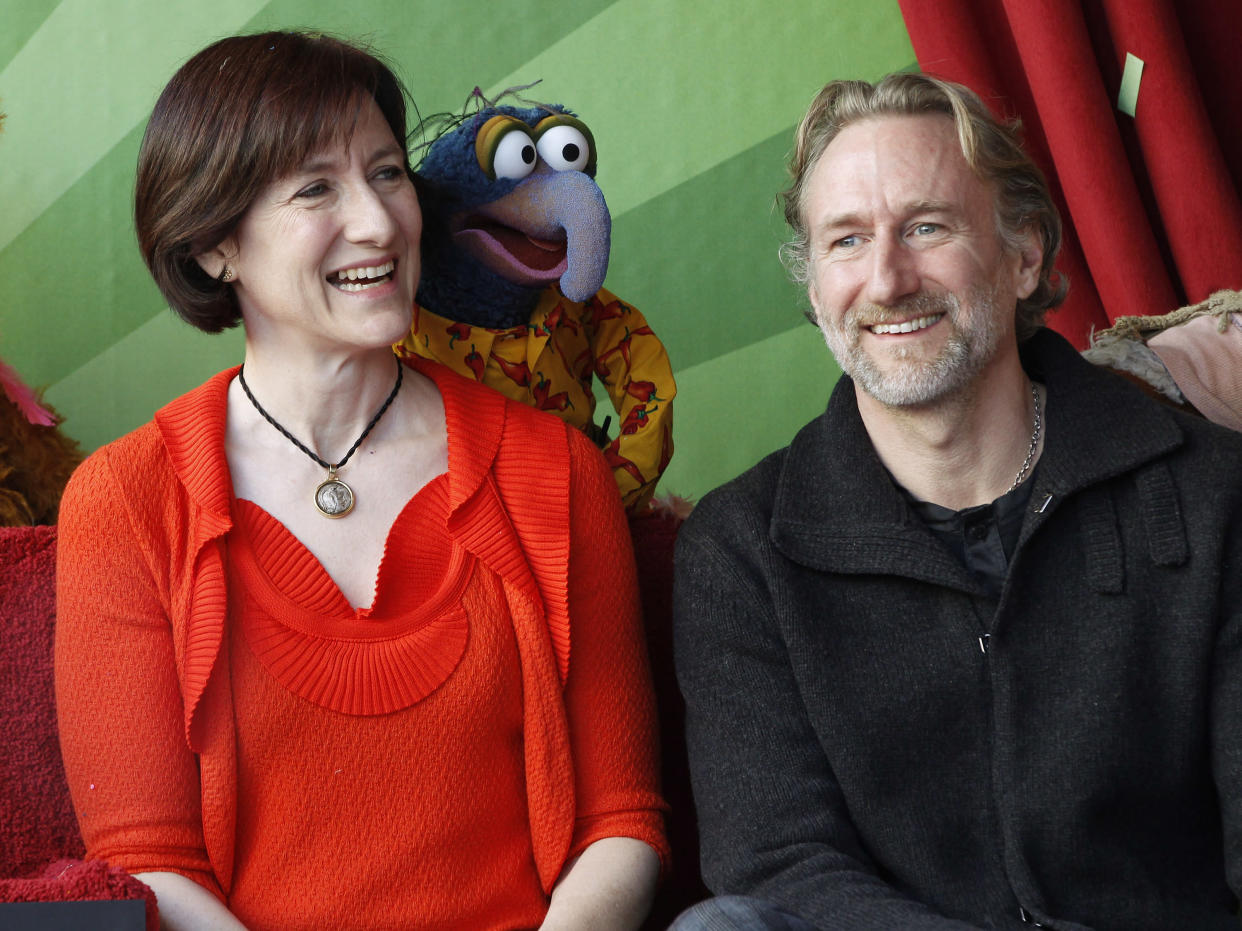 Muppet character Gonzo is pictured with Lisa Henson (L) CEO of The Jim Henson Company and her brother Brian Henson, chairman of The Jim Henson Company during ceremonies honoring the Muppets with a star on the Hollywood Walk of Fame in Hollywood, California March 20, 2012. REUTERS/Fred Prouser (UNITED STATES - Tags: ENTERTAINMENT)