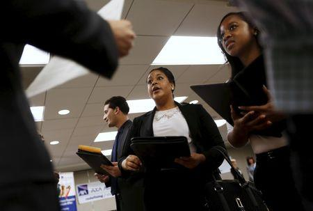 Job seekers listen to prospective employers during a job hiring event in San Francisco
