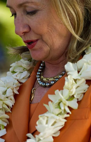 U.S. Secretary of State Hillary Rodham Clinton wears her black pearl necklace, a gift from Cook Island Prime Minister Henry Puna, during an event on sustainable development and conservation, in Rarotonga, Cook Islands, Friday, Aug. 31, 2012. (AP Photo/Jim Watson, Pool)