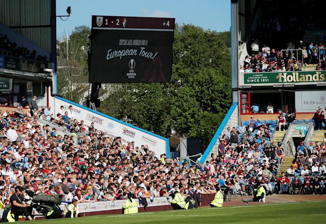 "Soccer Football - Premier League - Burnley vs AFC Bournemouth - Turf Moor, Burnley, Britain - May 13, 2018 General view of the scoreboard and Burnley fans after the match as they qualified for the Europa League Action Images via Reuters/Craig Brough EDITORIAL USE ONLY. No use with unauthorized audio, video, data, fixture lists, club/league logos or ""live"" services. Online in-match use limited to 75 images, no video emulation. No use in betting, games or single club/league/player publications. Please contact your account representative for further details."
