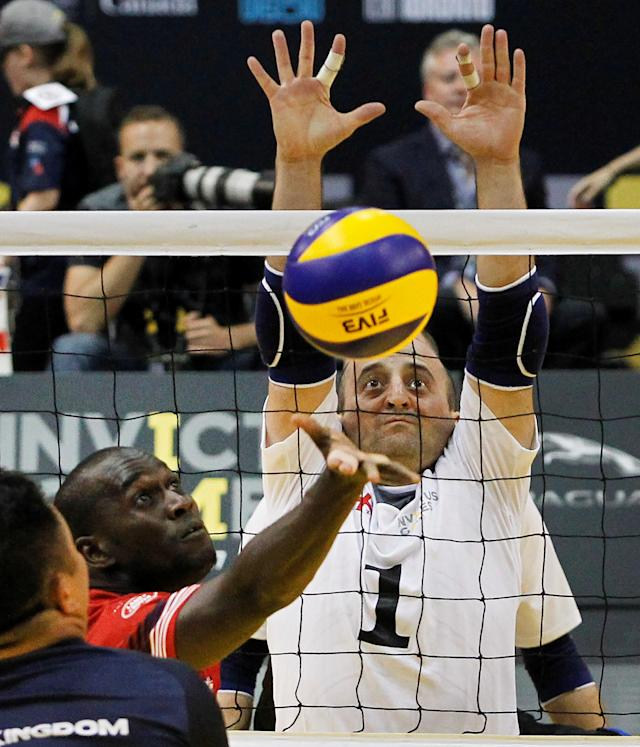 Britain and Georgia play in the gold medal match of Sitting Volleyball at the Invictus Games in Toronto, Ontario, Canada September 27, 2017. REUTERS/Fred Thornhill
