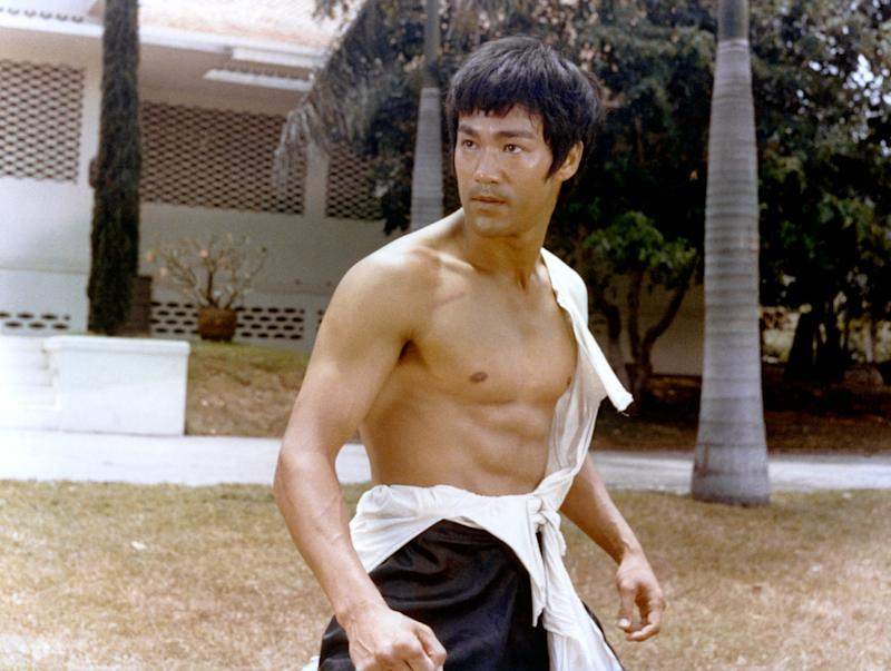"""A shirtless Lee on the set of """"Tang Shan Da Xiong"""" (""""Big Boss""""), written and directed by Wei Lo. (Photo: Sunset Boulevard via Getty Images)"""
