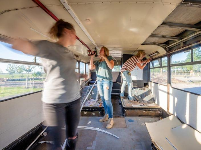the three women renovating the interior of the bus