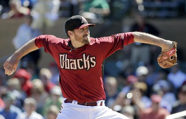 Arizona Diamondbacks starting pitcher Bo Schultz throws to the San Diego Padres during the second inning of a spring training baseball game in Scottsdale, Ariz., Sunday, March 9, 2014. (AP Photo/Chris Carlson)