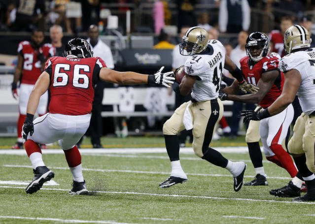 New Orleans Saints strong safety Roman Harper (41) returns a fumble as Atlanta Falcons guard Peter Konz (66) reaches to make a tackle in the first half of an NFL football game in New Orleans, Sunday, Sept. 8, 2013. (AP Photo/Bill Haber)