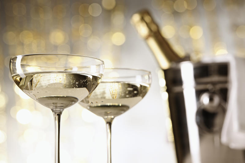 Two glasses of champagne, bottle and cooler in the background, selective focus [url=http://www.istockphoto.com/my_lightbox_contents.php?lightboxID=1051212][img]http://i60.photobucket.com/albums/h12/silberkorn/Wein_final.jpg[/img][/url]