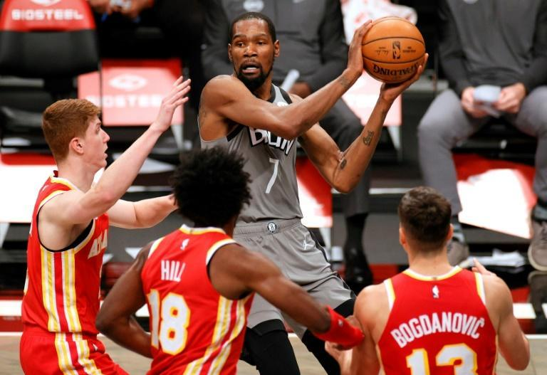 Brooklyn's Kevin Durant looks to pass against Atlanta's Kevin Huerter, Solomon Hill and Bogdan Bogdanovic in the Nets' 145-141 NBA victory over the Hawks