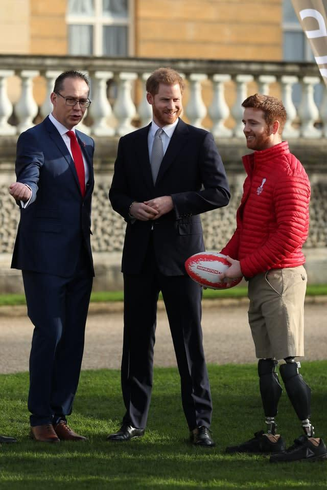 Tournament chief executive Jon Dutton, left, seen with the Duke of Sussex and Leeds wheelchair player James Simpson during the World Cup draws at Buckingham Palace, says the tournament remains on track despite the coronavirus outbreak (Yui Mok/PA)
