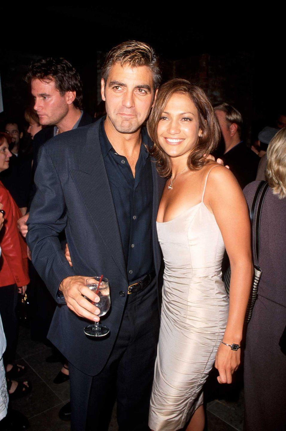 <p>In 1998, George Clooney and Jennifer Lopez got cozy for a photo at the movie premiere of <em>Out of Sight</em>. And somehow, they haven't aged one bit. </p>