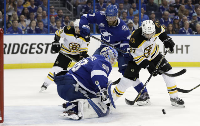 Tampa Bay Lightning goaltender Andrei Vasilevskiy (88) stops a shot by Boston Bruins center Patrice Bergeron (37) during the first period of Game 2 of an NHL second-round hockey playoff series Monday, April 30, 2018, in Tampa, Fla. Defending for Tampa Bay is defenseman Victor Hedman (77). (AP Photo/Chris O'Meara)