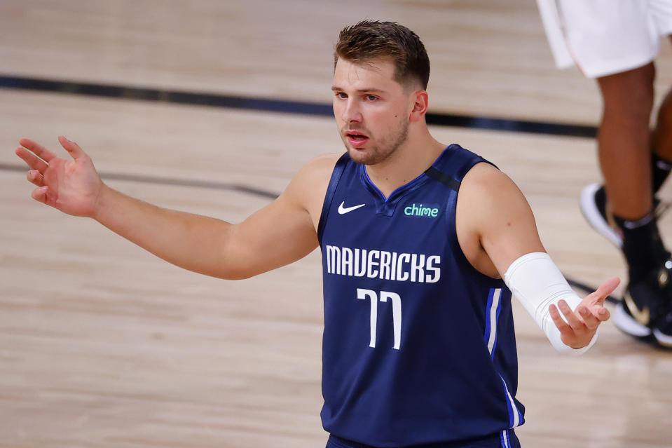 Luka Doncic #77 of the Dallas Mavericks reacts against the LA Clippers in Game Four of the Western Conference First Round during the 2020 NBA Playoffs at AdventHealth Arena at ESPN Wide World Of Sports Complex on August 23, 2020 in Lake Buena Vista, Florida. NOTE TO USER: User expressly acknowledges and agrees that, by downloading and or using this photograph, User is consenting to the terms and conditions of the Getty Images License Agreement.  (Photo by Kevin C. Cox/Getty Images)