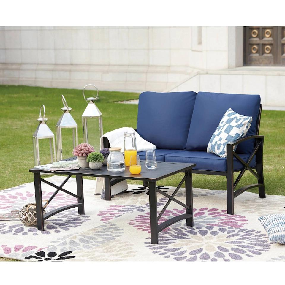 <p>No one can miss the bold blue cushions on the <span>Loveseat Patio Seating Set</span> ($536).</p>