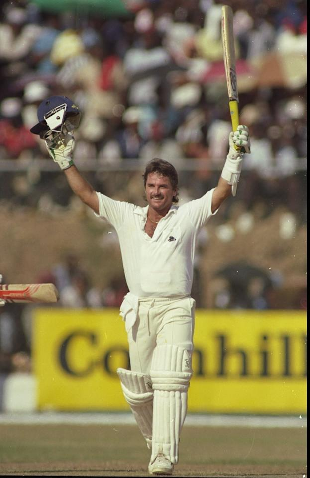 Undated:  Allan Lamb of England celebrates his innings of 100 runs during a Test match in Jamaica. \ Mandatory Credit: Adrian  Murrell/Allsport