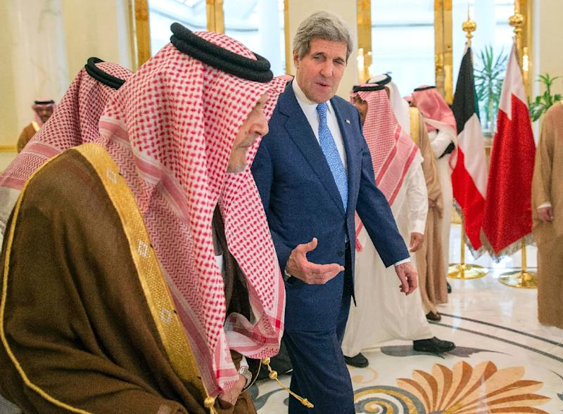 US Secretary of State John Kerry (right) talks with Saudi Foreign Minister Prince Saud al-Faisal during a meeting in Riyadh, on March 5, 2015