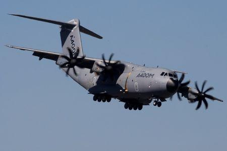 An Airbus A400M aircraft flies during a display on the first day of the 52nd Paris Air Show at Le Bourget airport near Paris