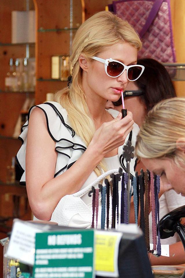 """On Sunday, Paris Hilton ventured from her Malibu beach home to also hit up the Malibu Country Mart, where she tested a new shade of lip gloss. Hey, these are big decisions! Pedro Andrade/<a href=""""http://www.pacificcoastnews.com/"""" target=""""new"""">PacificCoastNews.com</a> - July 10, 2011"""