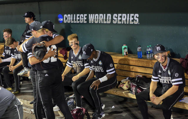 Mississippi State players sit in the dugout following their 5-2 loss to Oregon State in an NCAA College World Series baseball elimination game in Omaha, Neb., Saturday, June 23, 2018. (AP Photo/Nati Harnik)