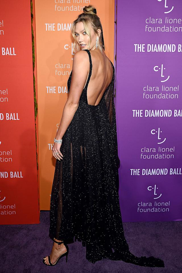 in a sheer black gown at Rihanna's 5th Annual Diamond Ball in N.Y.C.