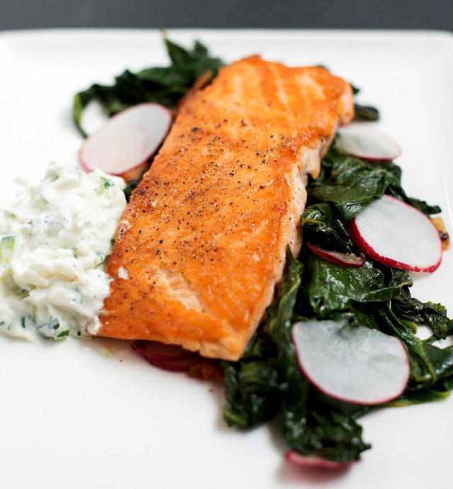 """<p>A creamy and cool radish raita adds an extra punch of protein to salmon when it's made with skyr. Get the recipe <a href=""""http://bsinthekitchen.com/pan-roasted-salmon-with-collard-greens-radish-raita?mbid=synd_yahoofood"""" rel=""""nofollow noopener"""" target=""""_blank"""" data-ylk=""""slk:here"""" class=""""link rapid-noclick-resp"""">here</a>.</p>"""