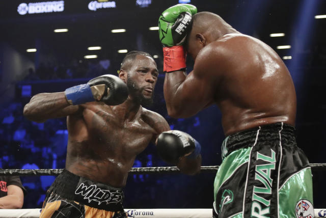 FILE - In this March 3, 2018, file photo, Deontay Wilder, left, fights Luis Ortiz during the third round of the WBC heavyweight championship bout in New York. Wilder won in the 10th round.Whatever disappointment Wilder may have had in not fighting Anthony Joshua or Tyson Fury next is gone. The heavyweight champion cant wait to get in the ring with Dominic Breazeale. (AP Photo/Frank Franklin II, File)