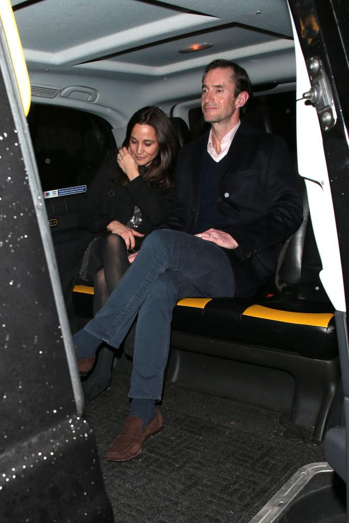 Pippa Middleton and James Matthews in a taxi at Princess Beatrice's engagement party at Chiltern Firehouse on 18 December 2019 in London.