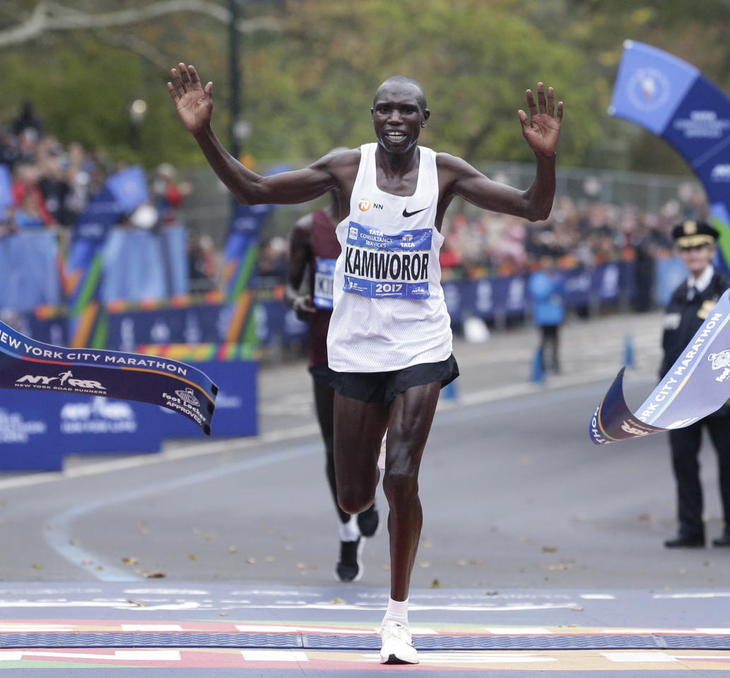<p>Geoffrey Kamworor of Kenya crosses the finish line first in the men's division of the New York City Marathon in New York, Nov. 5, 2017. (Photo: Seth Wenig/AP) </p>