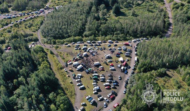 Undated handout photo issued by South Wales Police showing an aerial view of the rave near the village of Banwen. South Wales Police had been trying to disperse the rave since Sunday afternoon when around 3,000 people congregated at a former opencast coalmine near the village of Banwen. By Monday morning, around 400 people remained, the force said, but it added it was having difficulty flushing them off the 4,000 acre site despite confiscating several sound systems.