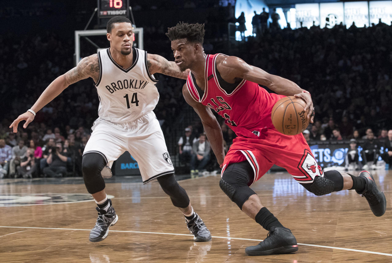 FILE - In this Saturday, April 8, 2017 file photo, Chicago Bulls forward Jimmy Butler (21) drives to the basket against Brooklyn Nets guard KJ McDaniels (14) during the second half of an NBA basketball game in New York. The Timberwolves are one of the teams that made significant roster changes this summer after a disappointing 31-win season in Tom Thibodeau's first year as coach. They added Jimmy Butler, Jeff Teague, Taj Gibson and Jamal Crawford while trading away Ricky Rubio in an offseason overhaul aimed at ending the league's longest active playoff drought at 13 seasons. (AP Photo/Mary Altaffer, File)
