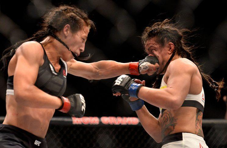 Joanna Jedrzejczyk (L) punches Claudia Gadelha during their title fight on Friday. (Getty)