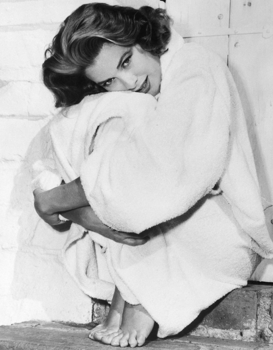 Kelly bundles up in her robe after a dip in the swimming pool at her home in Hollywood, 1954.