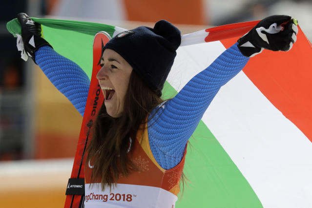 <p>Italy's Sofia Goggia celebrates after winning gold in the women's downhill at the 2018 Winter Olympics in Jeongseon, South Korea, Wednesday, Feb. 21, 2018. (AP Photo/Michael Probst) </p>