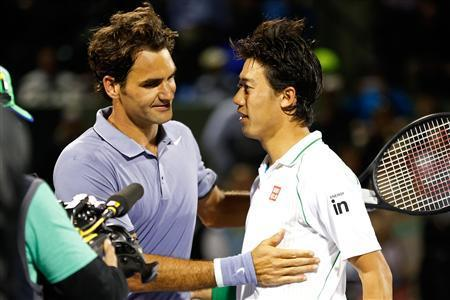 Mar 26, 2014; Miami, FL, USA; Kei Nishikori (R) shakes hands with Roger Federer (L) after their match on day ten of the Sony Open at Crandon Tennis Center. Geoff Burke-USA TODAY Sports